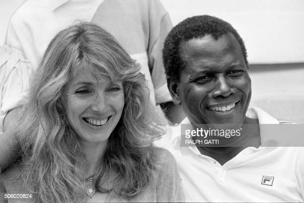 Photo taken on June 25, 1983 shows Bahamian-American actor Sidney Poitier and his wife Joanna Shimkus during the Monte-Carlo ATP Masters Series...