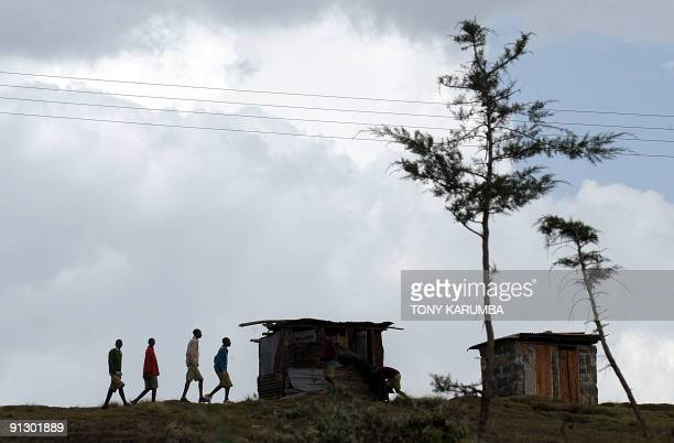 Photo taken on June 25 2009 a group of Kalenjin youth on a ridge walking by an Internally displaced persons camp in Kenya's Molo district where many...