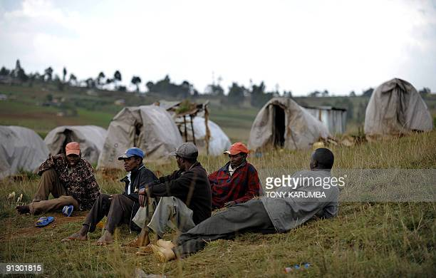 Photo taken on June 25 2009 shows men lying on the ground at an Internally displaced persons camp in Kenya's Molo district where many members of the...