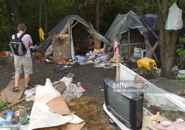 A photo taken on June 25 2018 shows a man looking at a Roma camp on the outskirts of Lviv which was abandoned after an attack Ukraine court has...