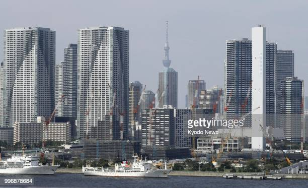 Photo taken on June 28 shows high-rise condominiums in Tokyo's Harumi waterfront area. Seen in the front is the athletes' village for the upcoming...