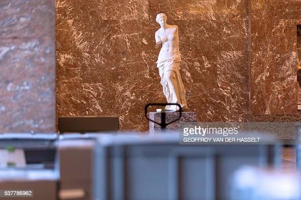Photo taken on June 3, 2016 shows boxes containing valuable artworks from the Louvre reserves stored near the Venus de Milo in one of the museum's...