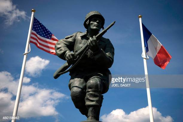 A photo taken on June 5 2014 in SainteMarieduMont Normandy shows a statue in honor of the US soldiers of the 82nd Airbone Division near the Utah...