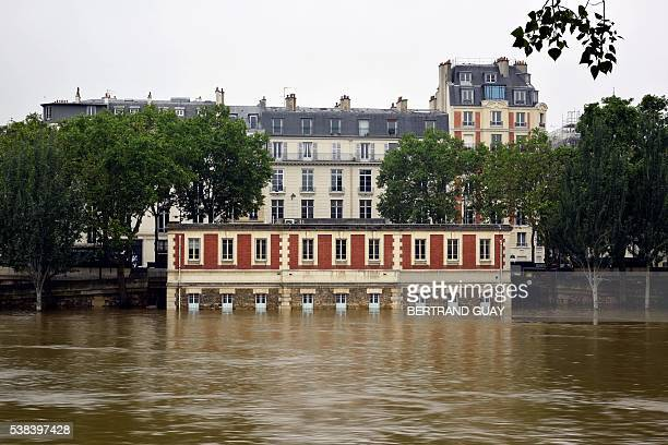 A photo taken on June 5 2016 shows the flooded river Seine in Paris Parisians were urged to stay away from the Seine which has spilled over its banks...