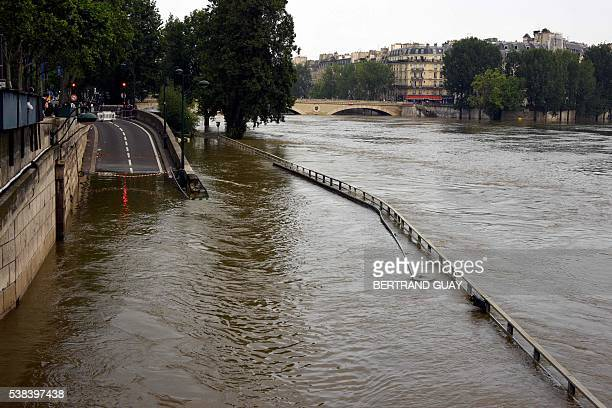 A photo taken on June 5 2016 shows the flooded Seine river in Paris Parisians were urged to stay away from the Seine which has spilled over its banks...