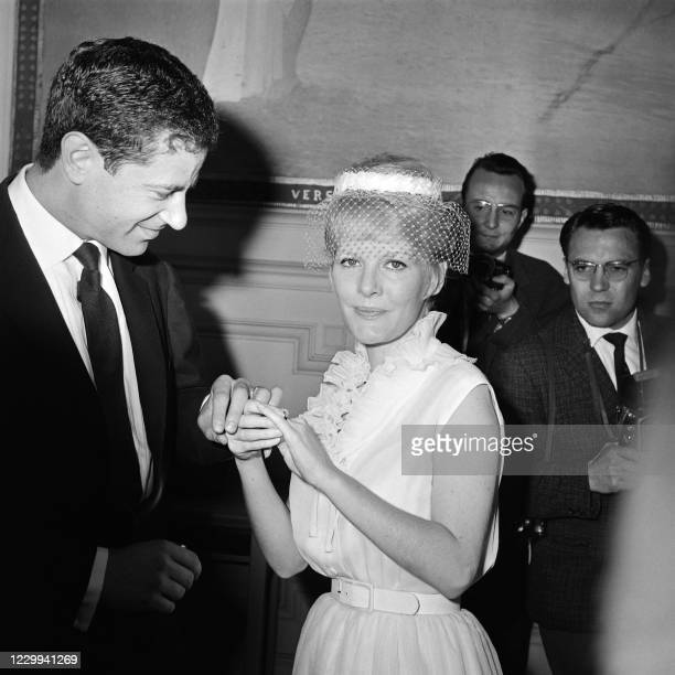 Photo taken on June 6, 1961 in Bourg-la-Reine shows British singer, actress and composer Petula Clark and her husband Claude Wolff, the publicist of...