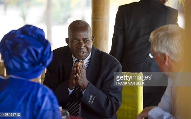 A photo taken on June 6 2012 shows Dutch Secretary of State Ben Knapen meeting with PierreClaver Mbonimpa at the Hotel Club du Lac Tanganyika in...