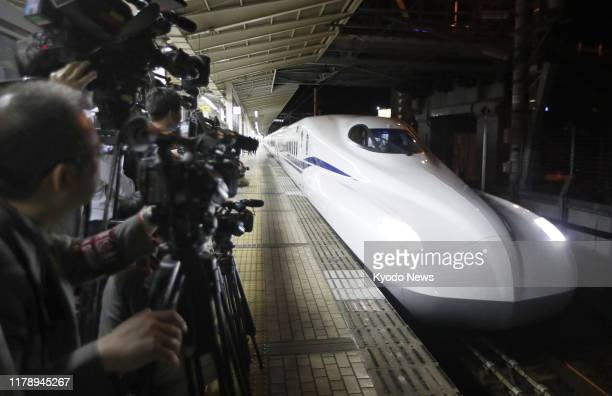 Photo taken on June 6 shows an N700S Tokaido Shinkansen bullet train entering Maibara station in western Japan for its test run between Maibara and...