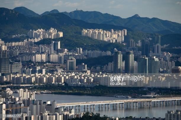 A photo taken on June 7 2019 shows a general view apartments and office buildings of the Yeouido district and Seoul city skyline