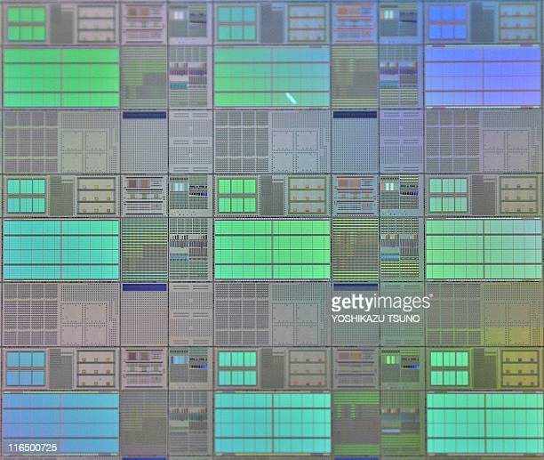 Photo taken on June 8 2011 shows a silicon wafer with large scale integrated circuits in Tokyo Japanese Tohoku University professor Hideo Ohno and...