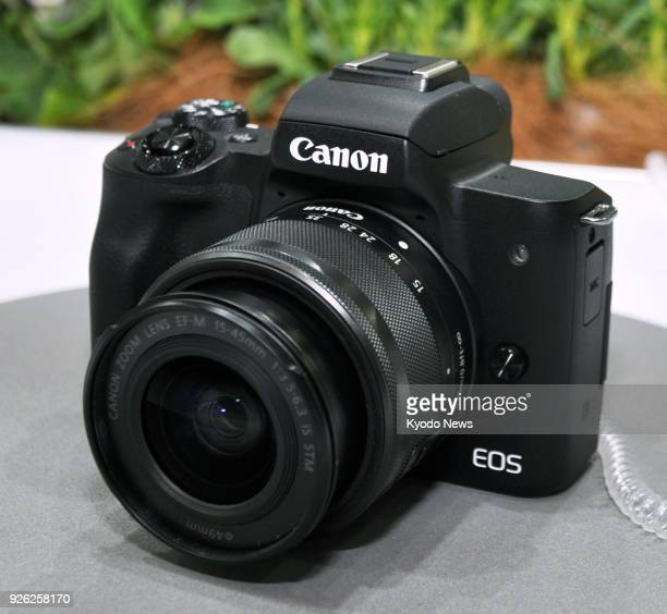 Photo taken on March 1 at a trade show in Yokohama Japan shows a Canon EOS Kiss M part of a new range of mirrorless cameras ==Kyodo