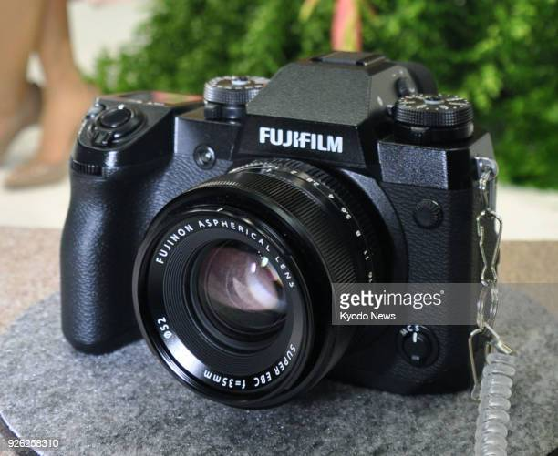 Photo taken on March 1 at a trade show in Yokohama Japan shows a Fujifilm XH1 part of a new range of mirrorless cameras ==Kyodo