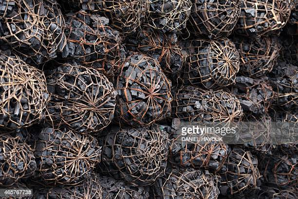 A photo taken on March 10 2015 shows charcoal at a depot in Dar es Salaam on March 10 2015 ARTI Energy is a Tanzanian company providing clean energy...