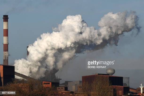 A photo taken on March 10 2017 shows smoke billowing from the steel giant ArcelorMittal plant in FossurMer southern France According to a survey done...
