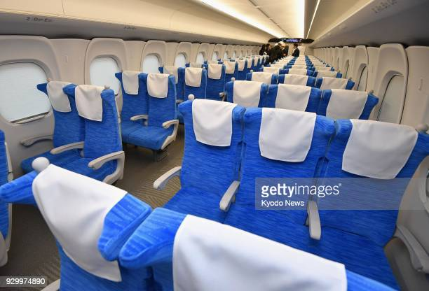 Photo taken on March 10 2018 shows the inside of Central Japan Railway Co's new bullet train N700S unveiled to the press in Hamamatsu Shizuoka...
