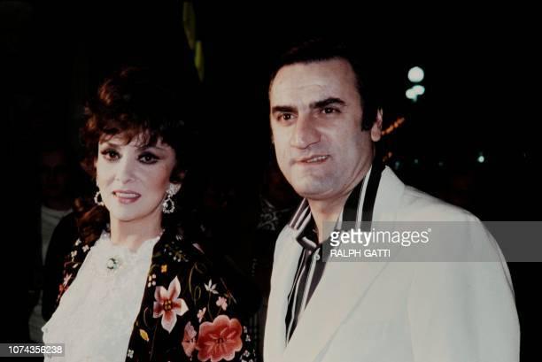 Photo taken on March 15 1980 shows Italian actors Gina Lollobrigida and Aldo Maccione during the 1st Italian Film Festival in Nice