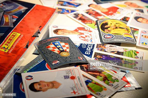 A photo taken on March 15 2016 shows Panini cards during the presentation of the new collection of football trading cards 'UEFA EURO 2016' in Paris /...