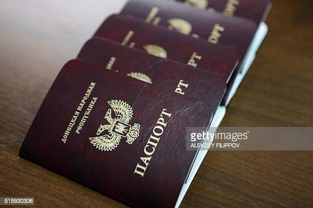 A photo taken on March 16 2016 shows new passports of the selfproclaimed People's Republic of Donetsk during a ceremony in Donetsk ProRussian rebels...