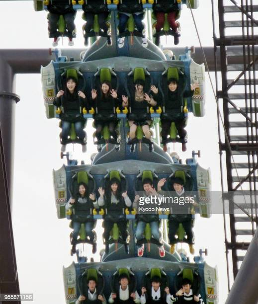 Photo taken on March 16 shows people riding the Flying Dinosaur roller coaster at Universal Studios Japan in Osaka western Japan ==Kyodo