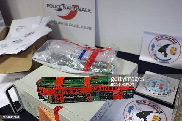 Photo taken on March 17 2015 in Marseille shows items seized by the police from a gang which committed telephone fraud using false premiumrate...