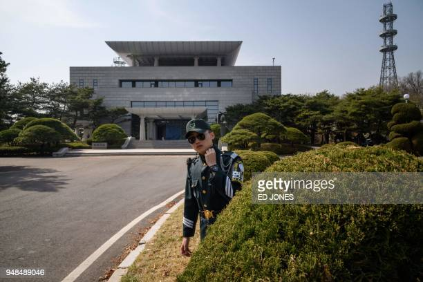 A photo taken on March 18 2018 shows a soldier standing before 'Peace Hall' the venue of an upcoming summit between South Korean president Moon Jaein...