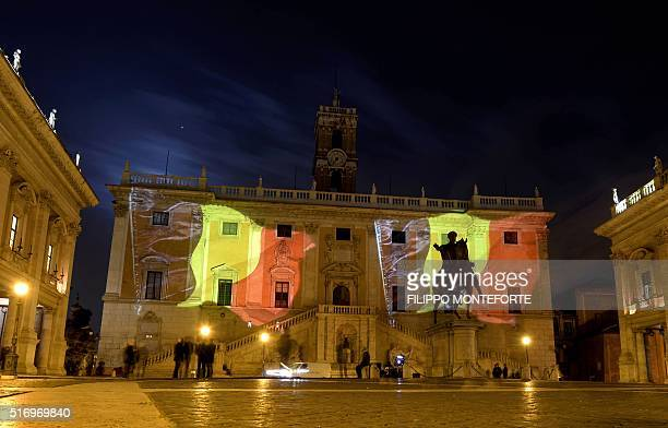 A photo taken on March 22 2016 shows the Belgian flag projected on Rome's Campidoglio in tribute to the victims of Brussels following triple bomb...