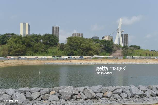 A photo taken on March 22 2019 shows a general view of the Cocody Bay during the official launch of the construction work of the 5th CocodyPlateau...