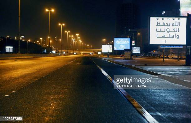 Photo taken on March 22, 2020 shows a deserted street in Kuwait city amid the COVID-19 coronavirus pandemic. - Kuwait imposed a curfew nationwide...