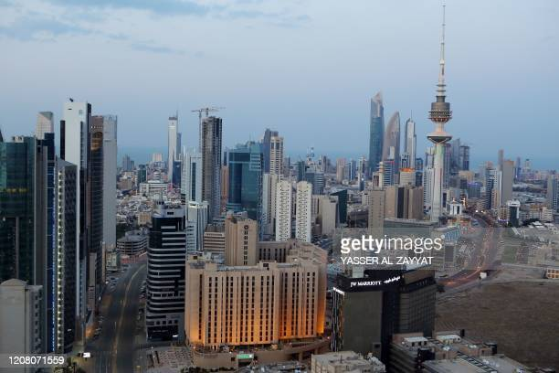 Photo taken on March 23 shows a general view of empty streets in Kuwait city, a day after authorities declared a nationwide curfew amid the COVID-19...