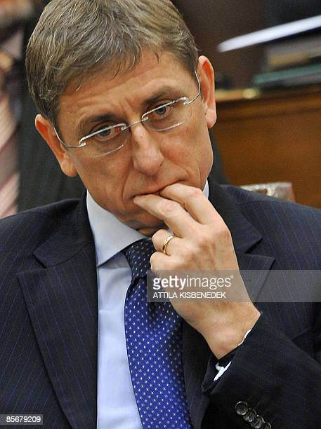Photo taken on March 23 shows acting Hungarian Prime Minister and president of the Hungarian Socialist Party Ferenc Gyurcsany, listening to the head...