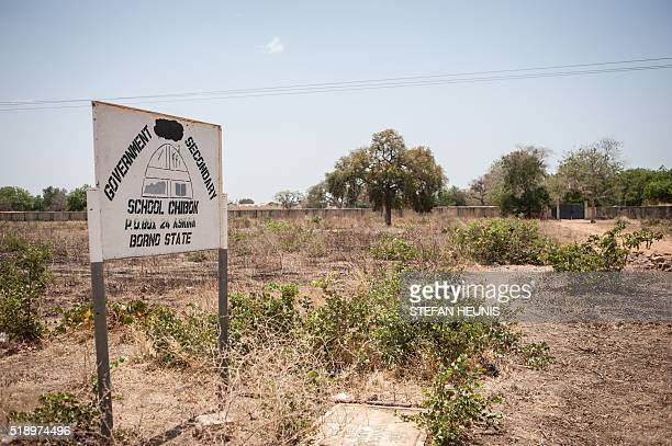 A photo taken on March 25 2016 shows a sign of the Government Girls Secondary School Chibok in Borno State northeastern Nigeria There's not much left...