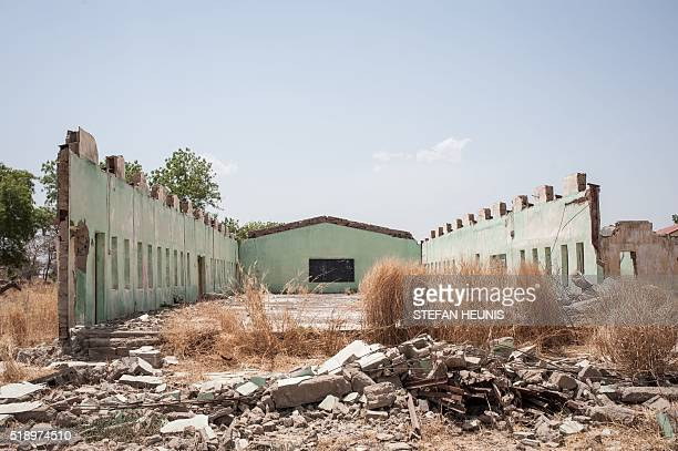 A photo taken on March 25 2016 shows the remains of the dilapidated school building at the Government Girls Secondary School Chibok in Borno State...