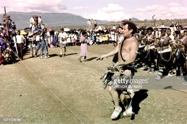 Photo taken on March 27 1989 in Keate's Drift shows Johnny Clegg leader of the pop group Savuka in a traditionnal Zulu garb during his wedding with...