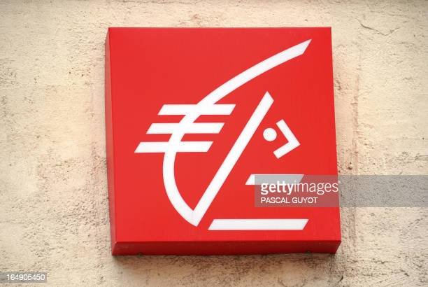 A photo taken on March 27 2013 shows the logo of the French bank Caisse d'Epargne at a branch in the center of the southern French city of...