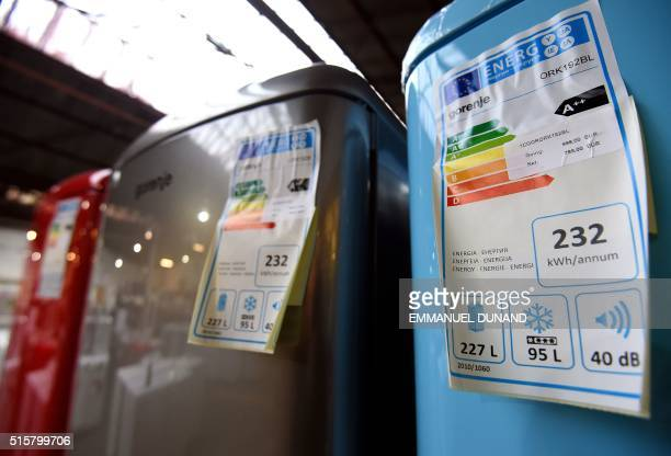 A photo taken on March 3 2016 shows energy rating labels on refrigerators in a store in Brussels An European project plans to revamp the energy...