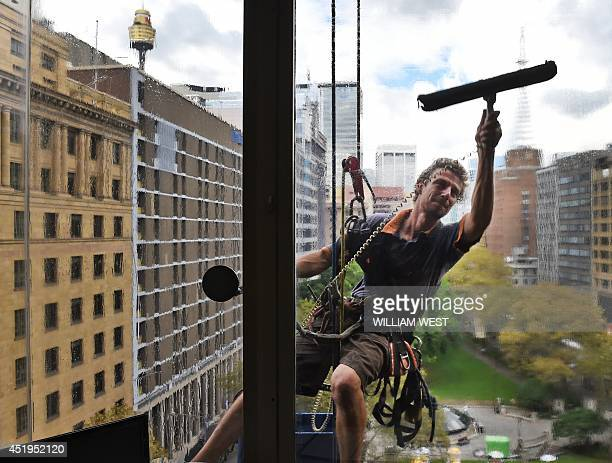 A photo taken on March 31 shows a window cleaner at work in Sydney's Central Business District as Australia's unemployment rate returned to a decade...