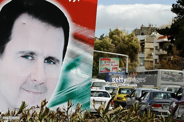 A photo taken on March 4 2015 shows a banner bearing a portrait of Syrian President Bashar alAssad in a street in the city of Damascus AFP PHOTO /...