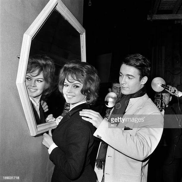 A photo taken on March 6 1959 at the SaintMaurice Studios shows French actress Brigitte Bardot and actor Jacques Charrier on the set of Babette s'en...