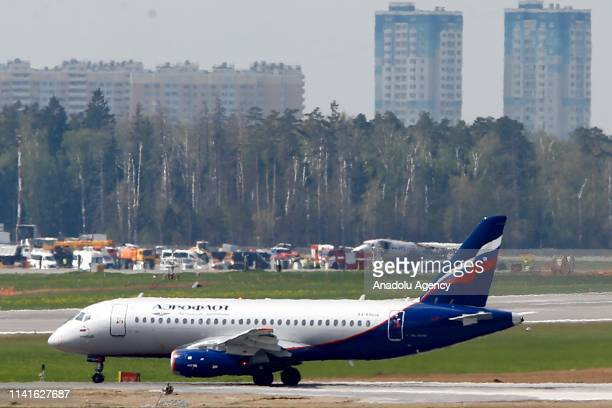 A photo taken on May 06 2019 shows the remains of a Russian Aeroflot plane that left up to 41 people killed after an emergency landing in Russian...
