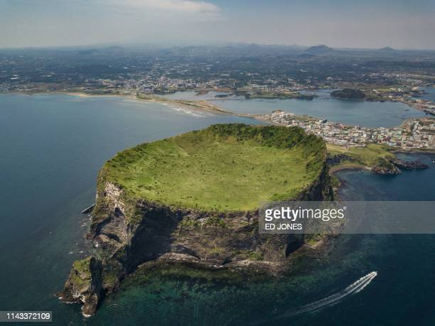 TOPSHOT A photo taken on May 10 2019 shows a general view of the Seongsan Ichulbong or 'Sunrise Peak' volcanic rock formation on Jeju island