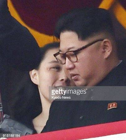 Photo taken on May 10 shows North Korean leader Kim Jong Un and his younger sister Kim Yo Jong watching a parade in Kim Il Sung Square in Pyongyang...
