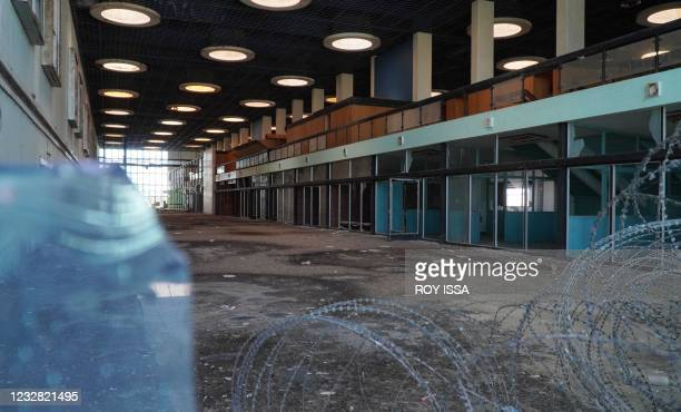 Photo taken on May 11, 2021 shows barbed wire around one of the halls at the abandoned Nicosia airport in the UN-protected zone of the divided...