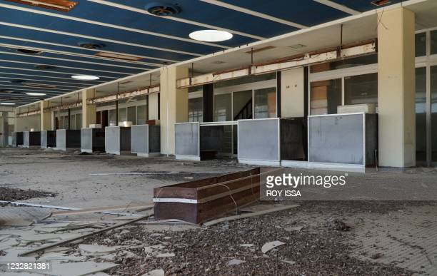 Photo taken on May 11, 2021 shows the check-in section of the departure hall in the abandoned Nicosia airport in the UN-protected zone of the divided...