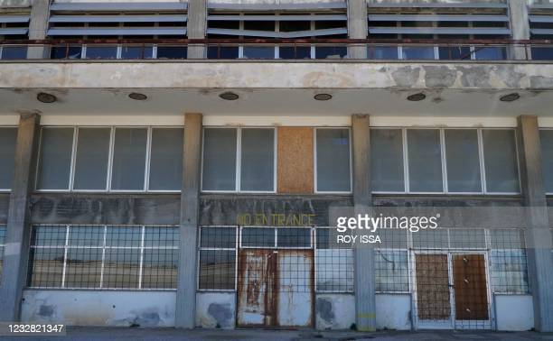 Photo taken on May 11, 2021 shows the facade of the abandoned Nicosia airport in the UN-protected zone of the divided Cypriot capital, 47 years after...