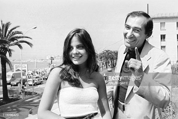 A photo taken on May 12 1979 shows French film director Alain Corneau posing with French actress Marie Trintignant during the 32th Cannes Film...