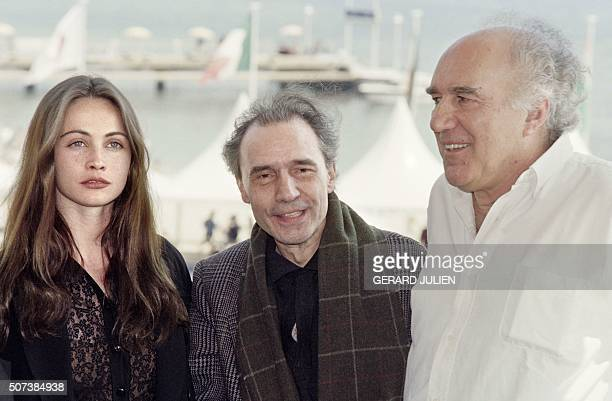 Photo taken on May 14, 1991 shows French film director Jacques Rivette posing with French actress Emmanuelle Beart and French actor Michel Piccoli at...