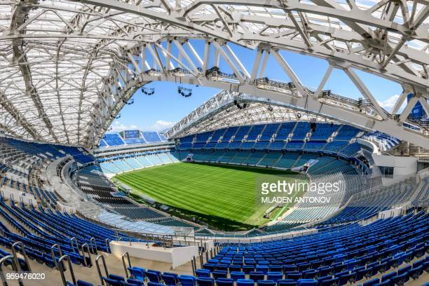 TOPSHOT A photo taken on May 17 2018 shows the pitch and the stands of the Fisht Olympic Stadium in Sochi During the 2018 FIFA World Cup in Russia...