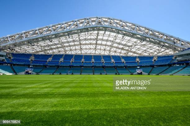 A photo taken on May 17 2018 shows the pitch and the stands of the Fisht Olympic Stadium in Sochi During the 2018 FIFA World Cup in Russia the...