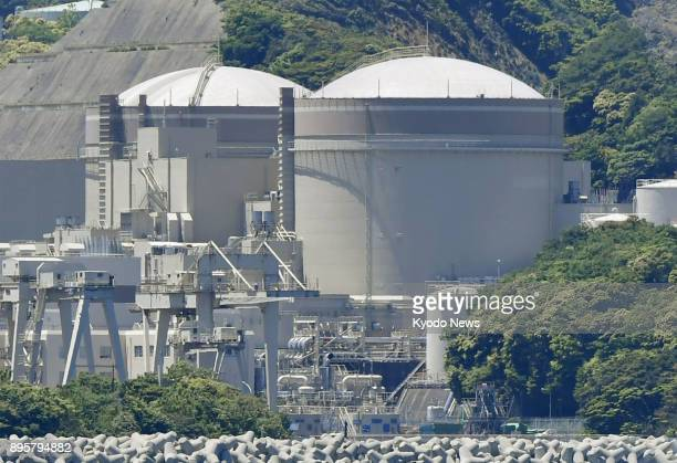 Photo taken on May 18 shows the Nos 1 and 2 reactors at Kansai Electric Power Co's Oi nuclear plant in Fukui Prefecture Kansai Electric's board is...