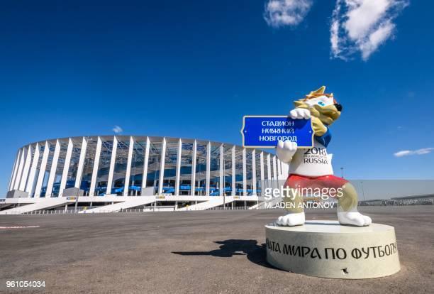 A photo taken on May 21 2018 shows FIFA World Cup 2018 mascot Zabivaka placed in front of the Nizhny Novgorod Arena in Nizhny Novgorod the stadium...
